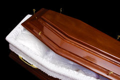 Brown coffin. Opened wooden coffin, studio shot, isolated, lace inside Stock Image