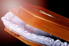Brown coffin, close-up inside view Stock Image