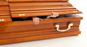 Brown coffin with hands Royalty Free Stock Photo