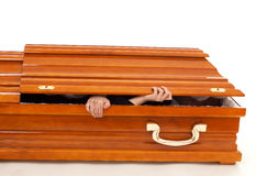Brown coffin with hands Stock Photo