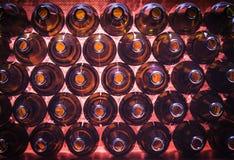 Brown color bottles background. Closeup stack of brown color bottles background stock images