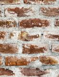 Brown color brick wall vertical texture background. stock photo