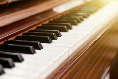 Brown color classical piano with black and white keys Royalty Free Stock Image