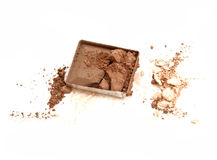 Brown color eyeshadow cracked on background. stock image