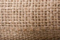 Brown color linen canvas as a background texture Stock Images