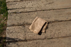 Brown color natural linen texture. Fabric on wood Royalty Free Stock Photography