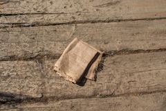 Brown color natural linen texture. Fabric on wood Stock Image