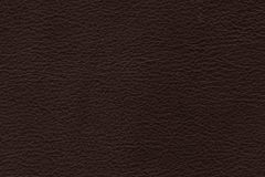 Brown color real leather background, closeup of genuine leather stock photography