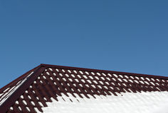 Brown color roof in snow. Stock Photos