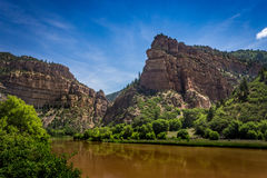 Brown Colorado River. Brown-colored Colorado River flowing through Glenwood Canyon near Hanging Lake, White River National Forest, Glenwood Springs, Colorado stock images