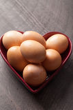Brown Colored Eggs vertical shot Stock Photos