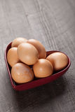 Brown Colored Eggs on wood Stock Image