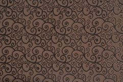 Brown colored patterned fabric texture. Details of the texture and weaving of brown fabric stock image