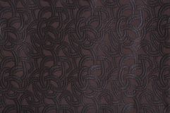 Brown colored patterned fabric texture royalty free stock photos