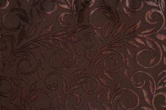 Brown colored patterned fabric texture. Details of the texture and weaving of brown fabric royalty free stock image