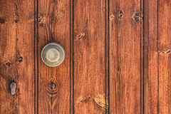 Brown colored wooden door texture with lock and handle Stock Photos