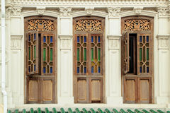 Brown colour wooden windows. With decoration from Singapore china town Stock Photo