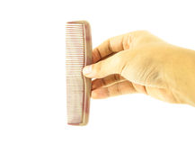 Brown comb in hand isolated Stock Photos