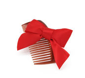 Brown comb with red bow Stock Images