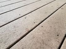 Brown composite deck wood. Or boards with screws royalty free stock images