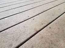 Brown composite deck wood. Or boards with screws royalty free stock image