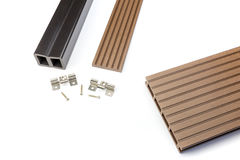Brown composite decking board with mounting material. Brown composite decking plank with fastening material Stock Photo