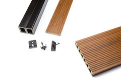 Brown composite decking plank with fixing material. Brown composite decking plank with fastening material on white background Stock Photo