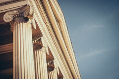 Brown Concrete Building With Pillars Against Clear Skies stock photos