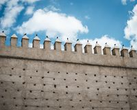 Brown Concrete Castle Wall Under Cumulos Clouds Stock Image