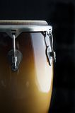 Brown conga drum Black Bk. An African brown Conga Drum isolated on black Background in the vertical or portrait view Royalty Free Stock Photography