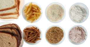 Brown contro bianco: Pane, pasta, riso e farina Fotografie Stock Libere da Diritti