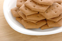 Brown cookies on plate Royalty Free Stock Photography