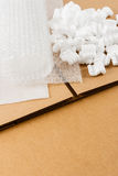 Brown Corrugate Box With Packing Supplies Stock Photo