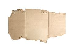 Brown corrugated cardboard torn isolated on white. Stock Image