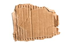 Brown corrugated cardboard torn piece isolated on white background.  royalty free stock photo