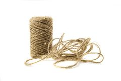 Brown cotton twine on white background. Brown cotton wool wood ball twine on white background isolated Royalty Free Stock Photography