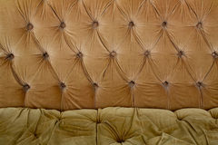 Brown couch background texture with sunken buttons Royalty Free Stock Photography
