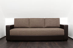 Brown couch in bright white interior Stock Images