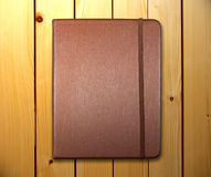 Brown cover note book on wooden background Royalty Free Stock Photography