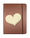 Brown cover notebook with heart shape paper Royalty Free Stock Photo