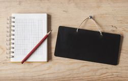 Blank notebook on desk background. Royalty Free Stock Image