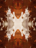 Brown Cow Hide Pattern. Brown and white kaleidoscope cow hide pattern Royalty Free Stock Images