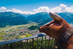 Brown cow statue on the Harder Kulm viewpoint. With Interlaken city view, Switzerland Stock Photography