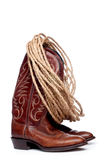 Brown cowboy boots and a coil of rope Stock Images