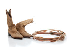 Brown cowboy boots and a lariat on white. Cowboy boots and lariat rope on white with copy space stock images