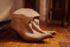 Brown cowboy boots. On a wooden floor Stock Images