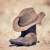 Cowboy spirit. Brown cowboy hat and boots outdoor stock image