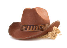 Brown cowboy hat and rope  on white Royalty Free Stock Photography