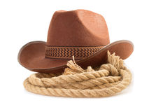 Brown cowboy hat and rope  on white Royalty Free Stock Images