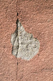 Brown crack and  fallen off plaster on wall Royalty Free Stock Photo